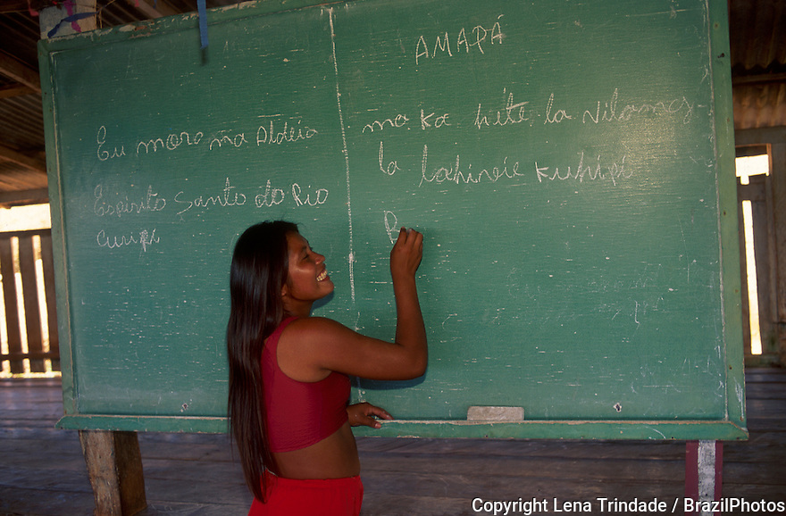 Indigenous school, native girl writes on blackboard in classroom, Espirito Santo do Rio Curupi Village, Karipuna do Amapa Indigenous People, Amapa State, Amazon rainforest, northern Brazil.