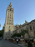Cathedral of Saint Mary of the See and La Giralda in Seville, it is the largest gothic cathedral in the world. It occupies the site of Hagia Sophia, a mosque built by the Almohads in the late 12th century. La Giralda, its bell tower, is a legacy from the Moorish structure.