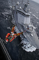 Air operations with Westland Lynx helicopter. Rescue swimmer being hoisted from Coastguard vessel during training.&#xD;&#xD;Coastguard vessel KV Svalbard patrols the northermost waters of Norway, including around the islands that she is named after. The main task is inspecting fishing boats, but she also performs search and rescue missions, and environmental monitoring.&#xD;&#xD;<br />  © Fredrik Naumann