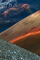 Massive cinder cones in varied colors dominate the natural landscape of the crater in HALEAKALA NATIONAL PARK on Maui in Hawaii