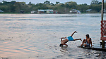 A boy dives into the Javari River at Atalaia do Norte in Brazil's Amazon region.