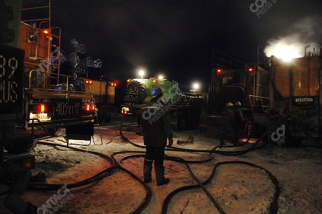 Workers during the night shift on a drilling rig on the Yuzhno-Russkoye natural gas field, one of Gazprom's newest fields, supplying gas destined for Europe. Yamal-Nenets Autonomous District, Russia, February 27, 2008