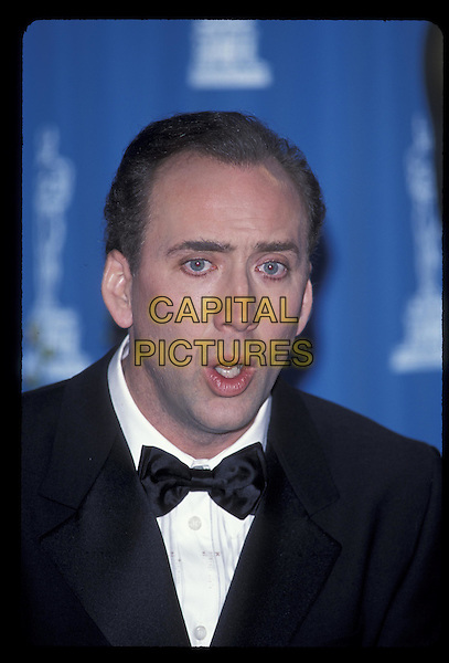 NICOLAS CAGE.Oscars 2001.Ref: 10754.portrait, headshot, bow tie.*RAW SCAN- photo will be adjusted for publication*.www.capitalpictures.com.sales@capitalpictures.com.©Capital Pictures