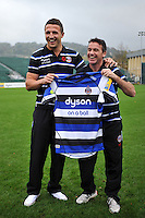 Bath Rugby's new signing Sam Burgess is presented with his shirt by Bath Head Coach Mike Ford during the media session. Bath Rugby Photocall on October 30, 2014 at the Recreation Ground in Bath, England. Photo by: Patrick Khachfe / Onside Images