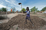 Juma Koko, 14, prepares the ground for planting in the Rhino Refugee Camp in northern Uganda. As of April 2017, the camp held almost 87,000 refugees from South Sudan, and more people were arriving daily. About 1.8 million people have fled South Sudan since civil war broke out there at the end of 2013. About 900,000 have sought refuge in Uganda. <br /> <br /> The boy's family fled from Yei, South Sudan, in 2016.