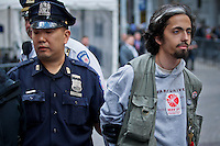 NEW YORK, NY - APRIL 20: A Member of Occupy Wall Street is arrested at the financial district during a spring training protest on April 20, 2012 in New York City