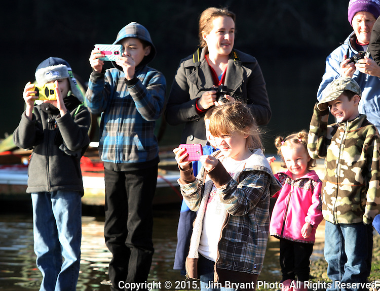 Young photographers  take pictures of family members jumping off the bridge into the Burley Lagoon during the 31st annual Polar Bear on January 1, 2015 in Olalla, Washington. Over 500 hardy participants joined in on the annual New Year's Day Tradition by jumping into the chilly lagoon waters during the annual Polar Bear Plunge. ©2015.  Jim Bryant Photo. All Rights Reserved.