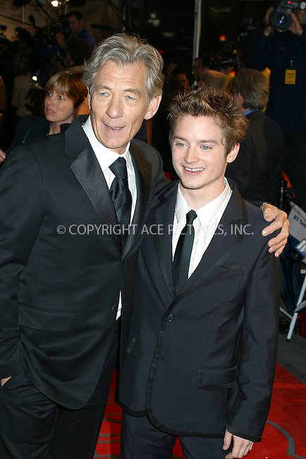 "Sir Ian McKellan and Elijah Wood arriving at ""GQ Men of the Year Awards"" in New York. October 16, 2002. Please byline: Alecsey Boldeskul/NY Photo Press.   ..*PAY-PER-USE*      ....NY Photo Press:  ..phone (646) 267-6913;   ..e-mail: info@nyphotopress.com"