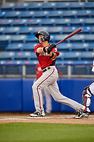 Potomac Nationals shortstop Carter Kieboom (5) follows through on a swing hits a single during the first game of a doubleheader against the Salem Red Sox on June 11, 2018 at Haley Toyota Field in Salem, Virginia.  Potomac defeated Salem 9-4.  (Mike Janes/Four Seam Images)