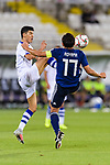 Dostonbek Khamdamov of Uzbekistan (L) competes for the ball with Aoyama Toshihiro of Japan (R) during the AFC Asian Cup UAE 2019 Group F match between Japan (JPN) and Uzbekistan (UZB) at Khalifa Bin Zayed Stadium on 17 January 2019 in Al Ain, United Arab Emirates. Photo by Marcio Rodrigo Machado / Power Sport Images