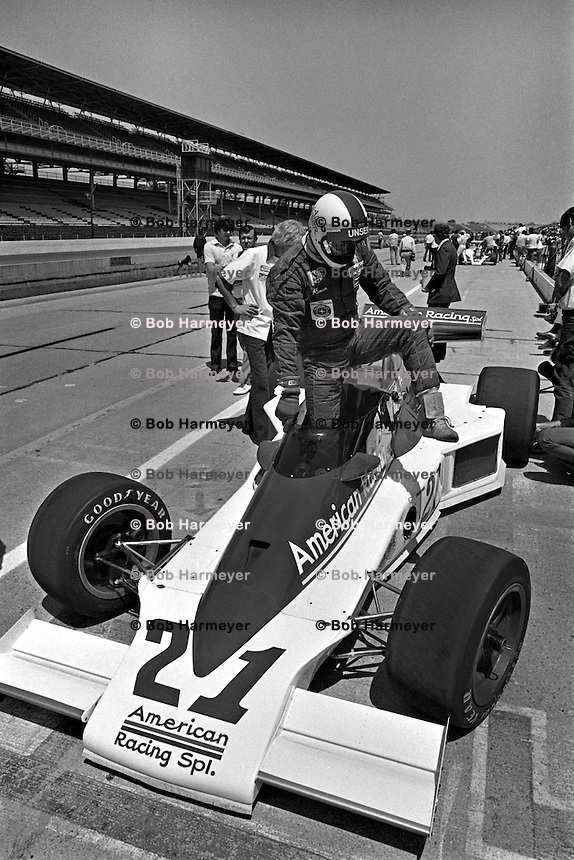INDIANAPOLIS, IN - MAY 29: Al Unser climbs into his Parnelli VPJ6B 001/Cosworth TC during practice for the Indianapolis 500 at the Indianapolis Motor Speedway in Indianapolis, Indiana, on May 29, 1977.