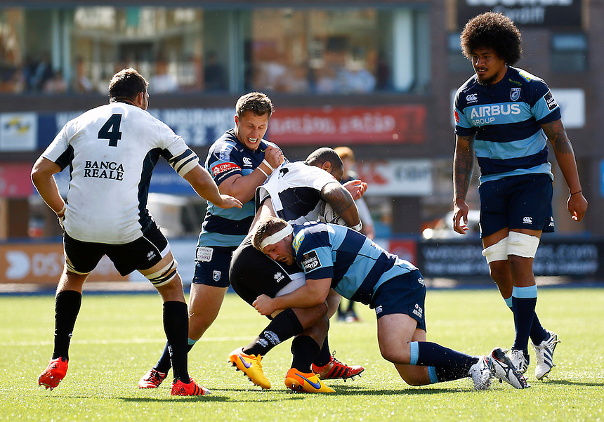 Cardiff Blues' Thomas Davies grapples with Zebre's Samuela Vunisa<br /> <br /> Photographer Simon King/CameraSport<br /> <br /> Rugby Union - Guinness PRO12 - Cardiff Blues v Zebre - Saturday 16th May 2015 - BT Sport Cardiff Arms Park - Cardiff<br /> <br /> &copy; CameraSport - 43 Linden Ave. Countesthorpe. Leicester. England. LE8 5PG - Tel: +44 (0) 116 277 4147 - admin@camerasport.com - www.camerasport.com