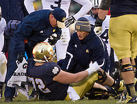 Center Nick Martin (72) is injured in the second quarter.