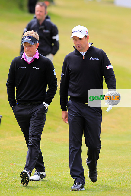 Luke Donald (ENG) and Padarig Harrington (IRL) walk down the 1st hole during Saturday's Round 3 of the 2015 Dubai Duty Free Irish Open, Royal County Down Golf Club, Newcastle Co Down, Northern Ireland 5/30/2015<br /> Picture Eoin Clarke, www.golffile.ie