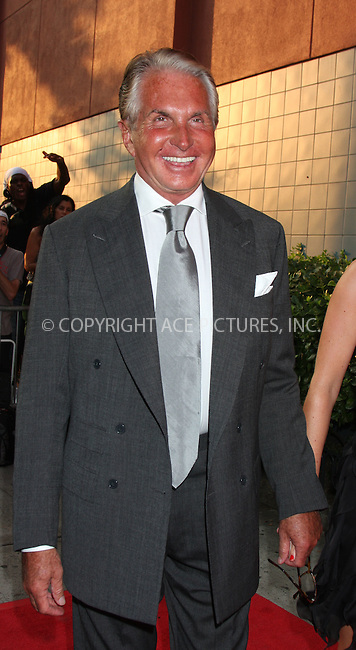 WWW.ACEPIXS.COM . . . . .  ....August 17 2009, New York City....George Hamilton arriving at The Cinema Society & Hugo Boss screening of 'Inglourious Basterds' at the SVA Theater on August 17, 2009 in New York City.....Please byline: AJ SOKALNER - ACE PICTURES.... *** ***..Ace Pictures, Inc:  ..tel: (212) 243 8787 or (646) 769 0430..e-mail: info@acepixs.com..web: http://www.acepixs.com