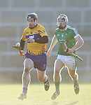 Tony Kelly of  Clare  in action against Cian Lynch of  Limerick during their NHL quarter final at the Gaelic Grounds. Photograph by John Kelly.