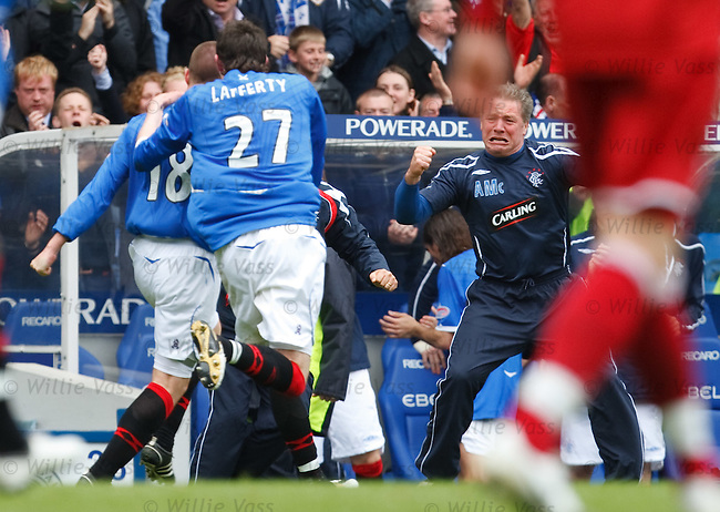 Ally McCoist roars his delight as Kenny Miller celebrates his goal