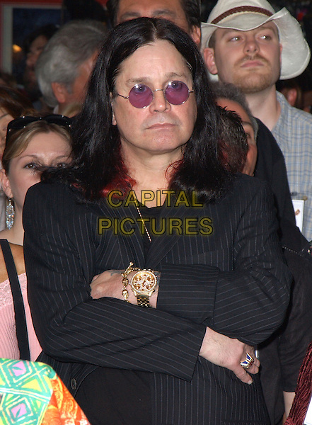 OZZY OSBOURNE.attends the ceremony to posthumously induct Randy Rhoads into the Hollywood Rockwalk in Hollywood, California .18 March 2004.*UK Sales Only*.half length, half-length.www.capitalpictures.com.sales@capitalpictures.com.©Capital Pictures.