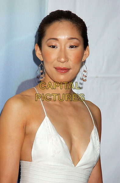 SANDRA OH.57th Annual Writers Guild Awards held at the Hollywood Palladium, Hollywood, California, USA,.19th February 2005  .portarit headshot earrings.Ref: ADM.www.capitalpictures.com.sales@capitalpictures.com.©Laura Farr/AdMedia/Capital Pictures
