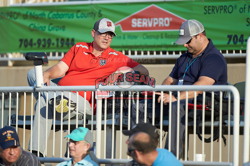 Minnesota Twins pro scout John Manuel (left) chats with Kansas City Royals pro scout Jon Williams during the South Atlantic League game between the Greensboro Grasshoppers and the Rapidos de Kannapolis at Kannapolis Intimidators Stadium on June 14, 2019 in Kannapolis, North Carolina. The Grasshoppers defeated the Rapidos de Kannapolis 4-1. (Brian Westerholt/Four Seam Images)