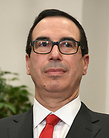 United States Secretary of the Treasury Steven Mnuchin prior to the arrival of US President Donald J. Trump to sign an Executive Order to promote healthcare choice and competition in the Roosevelt Room of the White House in Washington, DC on Thursday, October 12, 2017.  The President's controversial plan is designed to make lower-premium health insurance plans more widely available.<br /> Credit: Ron Sachs / Pool via CNP /MediaPunch