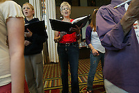 "Southern Arizona Women's Chorus member Sue Alexander (SUE ALEXANDER) sings during a rehearsal at the Grand Hyatt in New York, NY on Friday, June 23, 2006.  The Chorus performed Brusa's ""Missa pro defunctis"" and Beach's ""The Rose of Avontown, Op. 30"" at Carnegie Hall on Sunday night."