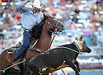 Kollin VonAhn competes in the team roping event at the Reno Rodeo in Reno, Nev., on Thursday, June 27, 2013.<br /> Photo by Cathleen Allison