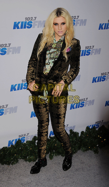 Ke$ha, Kesha Rose Sebert.The KIIS FM's Jingle Ball 2012 held at Nokia Theatre L.A. Live in Los Angeles, California, USA..December 3rd, 2012.full length black green scarf print brown gold velvet pattern.CAP/ROT/TM.©Tony Michaels/Roth Stock/Capital Pictures