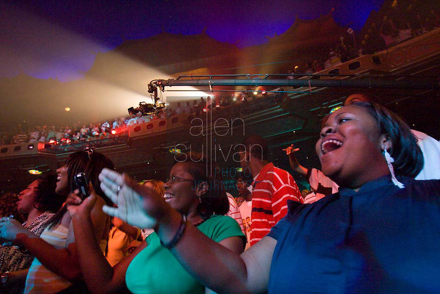 The crowd watches Rich Boy perform during a Boost Mobile RockCorps concert at The Fox Theatre in Atlanta on Saturday, June 9, 2007.