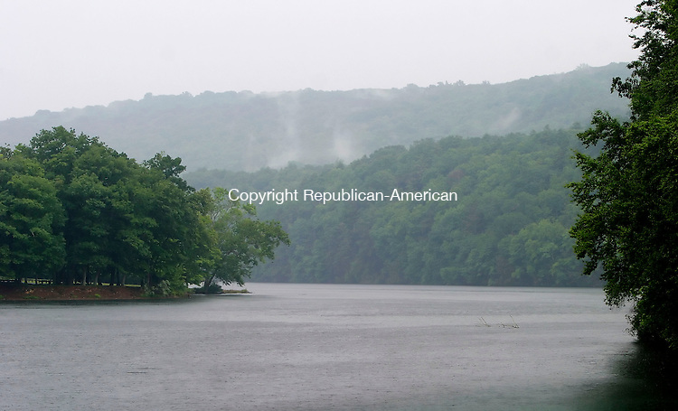 SOUTHBURY, CT 6/27/07- 062707BZ06- FOR COUNTRY LIFE- Mist rises from the treeline as a fast-moving rain shower passed  Kettletown State Park in Southbury Wednesday.<br /> Jamison C. Bazinet Republican-American