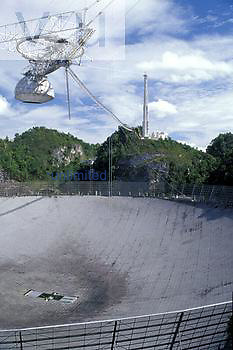 Ionospheric Observatory suspended feed platform and spherical reflector below, Arecibo, Puerto Rico.