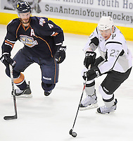 San Antonio Rampage's Wacey Rabbit (23) evades Oklahoma City Barons' Taylor Chorney during the first period of an AHL hockey game, Thursday, May 10, 2012, in San Antonio. (Darren Abate/pressphotointl.com)