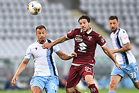 Stefan Radu of SS Lazio and Simone Verdi of Torino FC compete for the ball during the Serie A football match between Torino FC and SS Lazio at stadio Olimpico in Turin ( Italy ), June 30th, 2020. Play resumes behind closed doors following the outbreak of the coronavirus disease. <br /> Photo Image Sport / Insidefoto