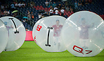 Chinese boys run inside big plastic balls as part of the opening ceremony before the friendly match between Bayern Munich and VfL Wolfsburg as part of the Audi Football Summit 2012 on July 26, 2012 at the Guangdong Olympic Sports Center in Guangzhou, China. Photo by Victor Fraile / The Power of Sport Images