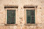 Walled city (stari grad) of Duvbrovnik, founded c. 972 along the Dalmatian Coast on the Adriatic Sea in Croatia--windows