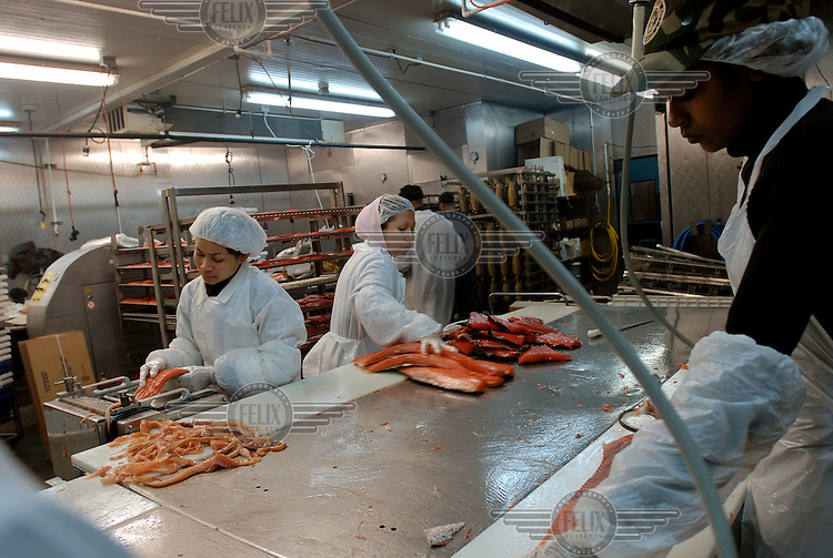 Workers prepare smoked salmon at the Banner Smoked Fish Inc. factory on Coney Island in Brooklyn. The factory is run by Avi Banner, an Orthodox Jew, and Banner produce is certified as kosher.