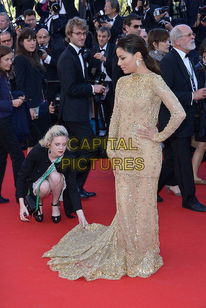 Eva Longoria.'Le Passe'  film premiere at the 66th Cannes Film Festival, Cannes, France, 17th May 2013..full length gold patterned beige nude dress long sleeve sleeved maxi train hand on hip assistant bending down adjusting .CAP/PL.©Phil Loftus/Capital Pictures