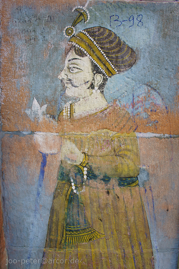 wall painting showing a wealthy man in traditional costume  in the streets of Jodhpur,  Rajastan, India