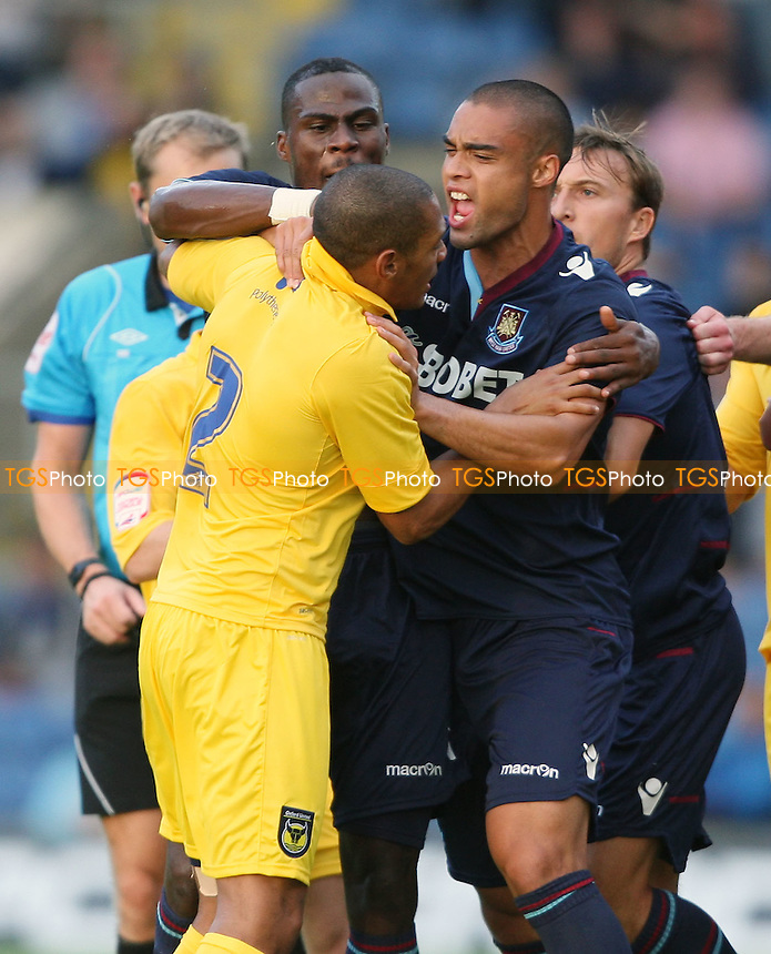 Guy Demel and Winston Reid of West Ham square up with Damian Batt after Mark Noble's challenge on Jon-Paul Pittman - Oxford United vs West Ham United, Pre-season Friendly at the Kassam Stadium, Oxford - 17/07/12 - MANDATORY CREDIT: Rob Newell/TGSPHOTO - Self billing applies where appropriate - 0845 094 6026 - contact@tgsphoto.co.uk - NO UNPAID USE..
