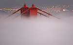 The Golden Gate Bridge tower stands out over the San Francisco fog.