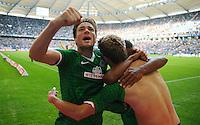 FUSSBALL   1. BUNDESLIGA   SAISON 2013/2014   6. SPIELTAG Hamburger SV - SV Werder Bremen                       21.09.2013 Clemens Fritz, Nils Petersen und Assani Lukimya (v.l., beide SV Werder Bremen) jubeln nach dem Tor zum 0:2