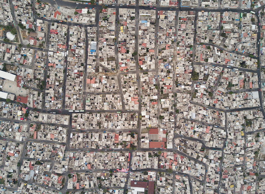 The neighborhood of Miravalle, Iztapalapa, on the skirts of the Xaltepec volcano in the valley of Mexico City.  Aerial drone photography/footage, Mexico City, Mexico