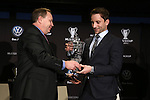 05 December 2013: Volkswagen executive Clark Campbell (left) presents Mike Magee (right) with the 2013 MLS MVP Trophy. Major League Soccer held a press conference announcing Mike Magee, of the Chicago Fire as the winner of the 2013 MLS Most Valuable Player award at the Three Points Club in Kansas City, Missouri.