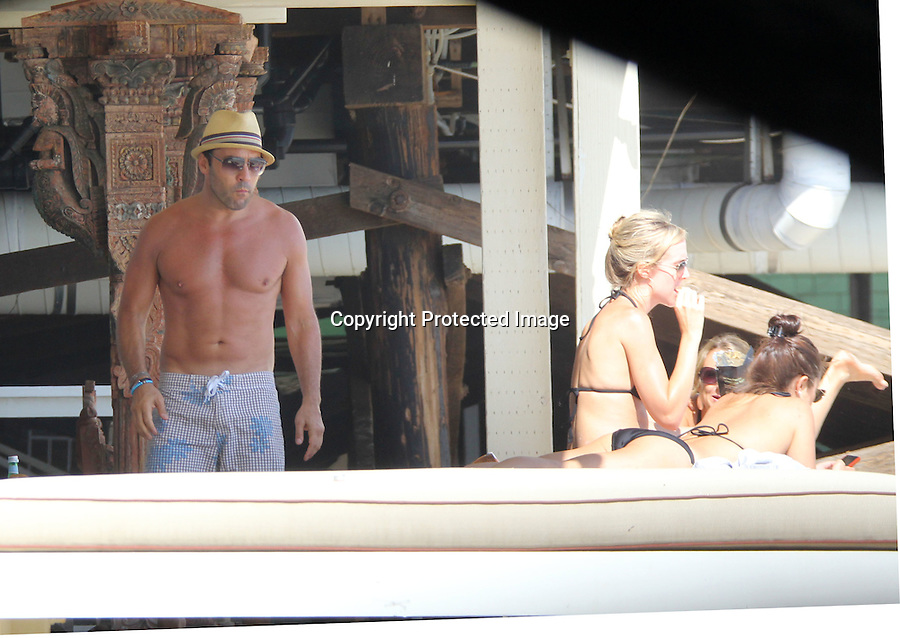 July 2nd 2011  Exclusive   Saturday ..Jeremy Piven shirtless on the beach in Malibu California partying with 5 girls at his beach house. Jeremy had some weird scars on his chest & looked like he was a little happy to see one of his girlfriends in a bikini. Jeremy was showing off his beach body & abs while walking on the beach. Jeremy was also text messaging while sitting on his balcony smoking a cigar ..Abilityfilms@yahoo.com.805-427-3519.www.AbilityFilms.com.