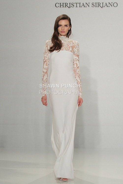Model walks runway in a long sleeve lace column gown, from the Christian Siriano for Kleinfeld bridal collection, at Kleinfeld on April 18, 2016 during New York Bridal Fashion Week Spring Summer 2017.