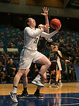 Idaho's Geraldine McCorkell drives the baseline and shoots past Portland State's Courtney West in a women's Big Sky Tournament semi-final game held at the Reno Events Center on Friday, March 9, 2018 in Reno, Nevada.