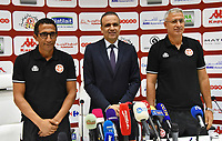 Tunisian Football Federation (FTF) President Wadii Jari (C) gives a press conference with new national football team coach Mondher Kbaier (R) at the federation headquarters in the capital Tunis on August 29, 2019. - Kbaier has been appointed coach of the Tunisian team in replacement of resigned French coach Alain Giresse. According to a statement issued by the Tunisian Federation (FTF), the new coach of the Carthage Eagles had signed a renewable three-year contract.PHOTO : Agence Quebec Presse - JDIDI_WASSIM