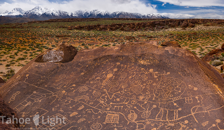 Sky rock petroglyphs and eastern sierra mountain range on a cloudy day. Ultra high-resolution panoramic image.