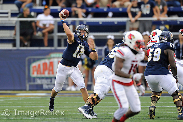 20 September 2014:  FIU quarterback Alex McGough (12) passes in the first half as the University of Louisville Cardinals defeated the FIU Golden Panthers, 34-3, at FIU Stadium in Miami, Florida.