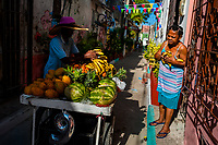 A Colombian vendor sells fruits in Getsemaní, a popular artistic neighborhood in Cartagena, Colombia, 16 December 2017. With the peace agreement, ending a 52-year civil conflict and promising political stability, together with rapid economic growth and unexploited tourism potential, Colombia has truly become a holiday destination. Cartagena, a UNESCO World Heritage site on the tropical Caribbean coast, plays the primary role in Colombia's tourism renaissance. The historic sites from the Spanish colonial times are being restored, private investments are visible throughout the city and an increased number of local people benefit from the boom of the travel related services.